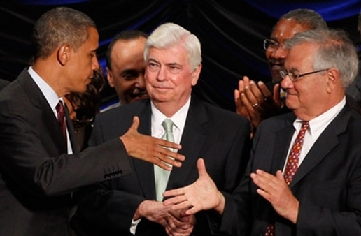 Obama shaking hands with Dodd (center) and Frank after signing their bill in 2010. (Photo:AP)