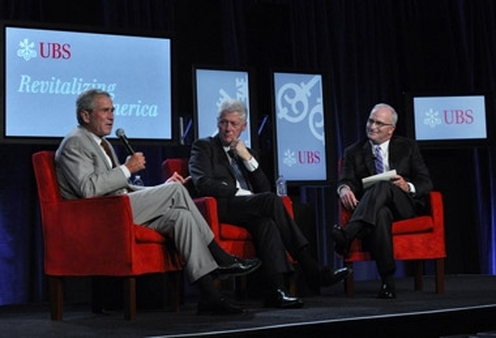 Presidents George Bush (left) and Bill Clinton (center) speaking with Robert McCann, head of UBS in the Americas.