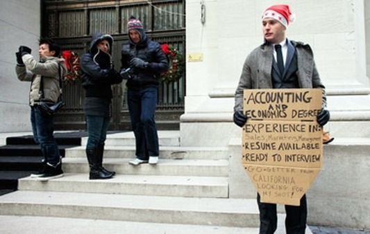 An unemployed man looking for work on Wall St. (Photo: AP)