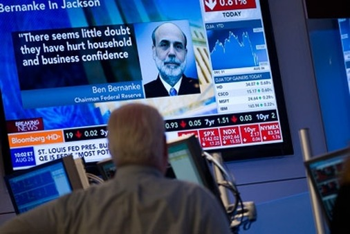 A NYSE trader watches a monitor after end of Ben Bernanke's speech on Friday. (Photo:AP)