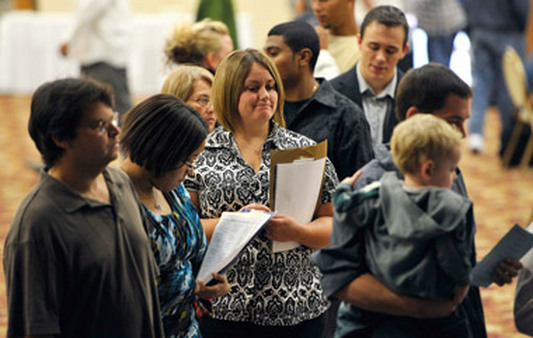 Unemployed standing in line at a jobs fair. (Photo: AP)