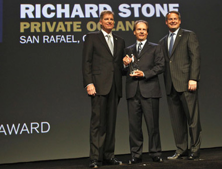 Bernie Clark (left) and Walt Bettinger (right) of Schwab give Leadership award to Richard Stone.