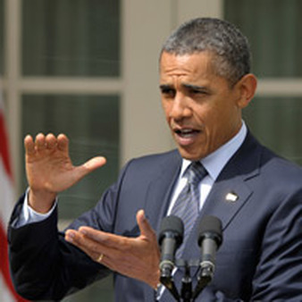 President Barack Obama signed into law on Monday a law repealing a 3% withholding tax. (AP photo)