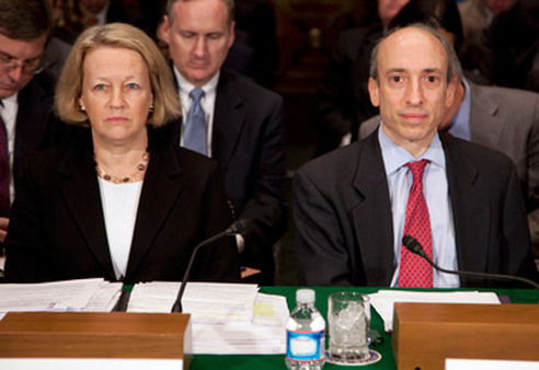 SEC Chairman Mary Schapiro and CFTC's Gary Gensler appearing Tuesday at Senate hearing. (Photo: AP)