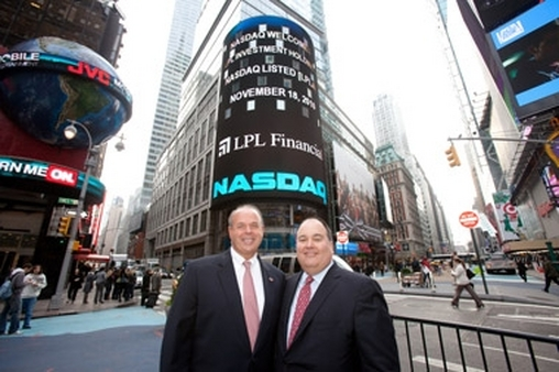 LPL's Robert Moore (left) and CEO Mark Casady in Times Square after their IPO in 2010.