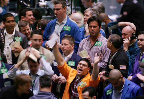 Gold traders on the floor of the NYMEX. (Photo: AP)