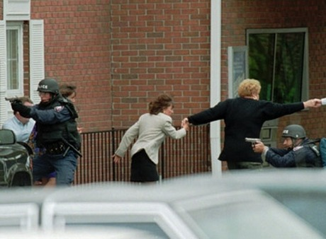 Hostages fleeing a bank robbery. (Photo: AP)