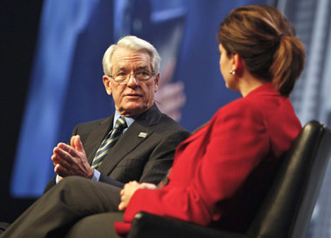 Charles Schwab speaking with CNBC's Maria Bartiromo at Schwab Impact in 2011.