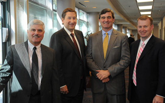 (From left) RJ's Dennis Zank, COO, and Chet Helck, CEO Global Private Client Group. Morgan Keegan's Dick Ferguson, President Private Client Group, and RJ's Tash Elwyn, President Private Client Group.