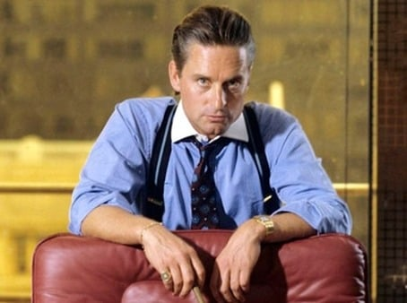 Michael Douglas, as villianous Gordon Gekko, appeared in suspenders and a tab collar in the 1987 hit film 'Wall Street.' (Twentieth Century Fox)