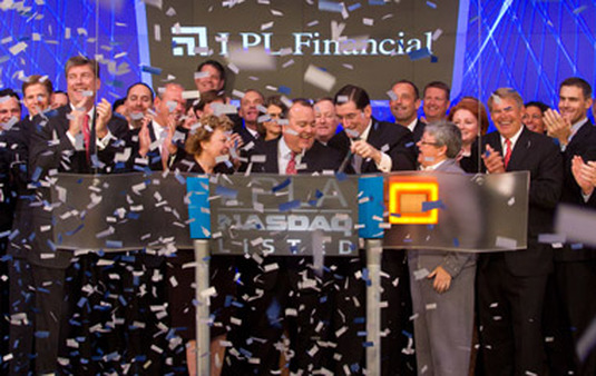 LPL executives celebrated their IPO in 2010. (Photo: AP)
