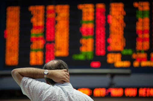 Man reacts to results on stock board. (Photo: AP)