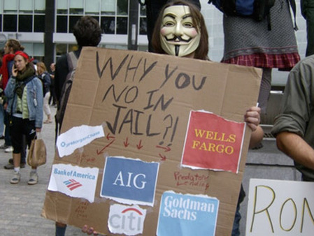 An Occupy Wall Street protester in September. Trust in banks has risen by two percentage points since December. (Photo: Joyce Hanson)