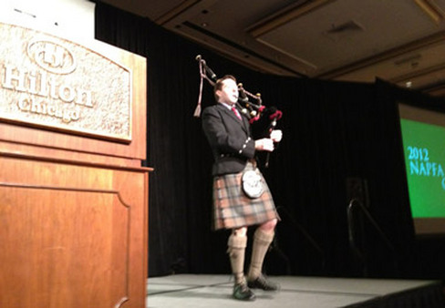 A bagpiper at the opening of NAPFA's 2012 conference.