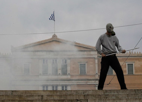 A protester wearing a gasmask near the Greek Parliament last year. (Photo: AP)