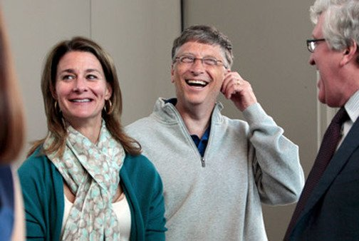 Bill Gates, center, and his wife, Melinda. Their foundation has a fund for making loans to NGOs and companies.
