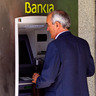 Spanish Banks Downgraded as Cyprus Seeks Bailout