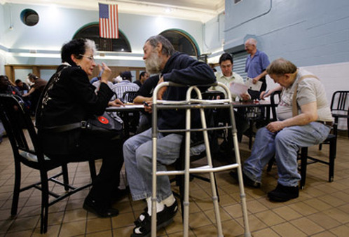 Worker talks with a man at a homeless shelter. (Photo: AP)