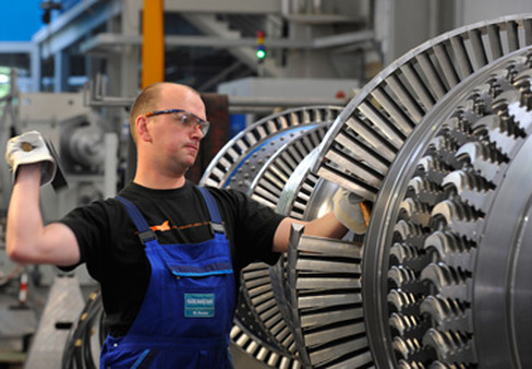 A worker in a Siemens plant in Germany, where unemployment rose for the fourth straight month. (Photo: AP)