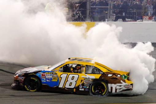 NASCAR driver Kyle Busch celebrated a win with a burnout. (AP Photo/LAT, Lesley Ann Miller)