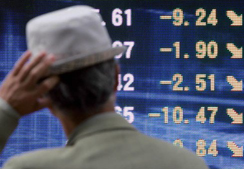 A stock board in Japan. (Photo: AP)