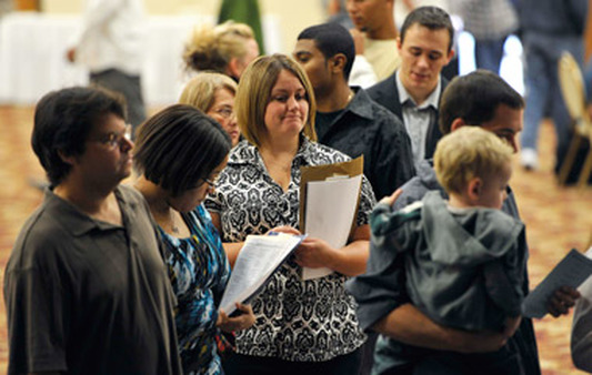 Unemployed people waited at a career fair. (Photo: AP)