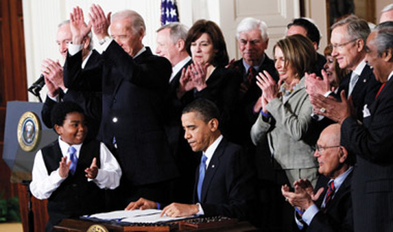 Obama signing his health care law, which many nonprofits support. (Photo: AP)