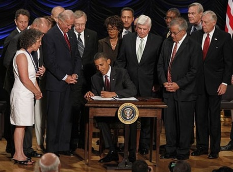 President Obama signing Dodd-Frank Act in 2010. (Photo: AP)