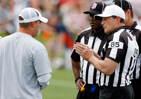 Ed Hochuli and his fellow refs will be back on the field beginning Thursday night. (AP photo)