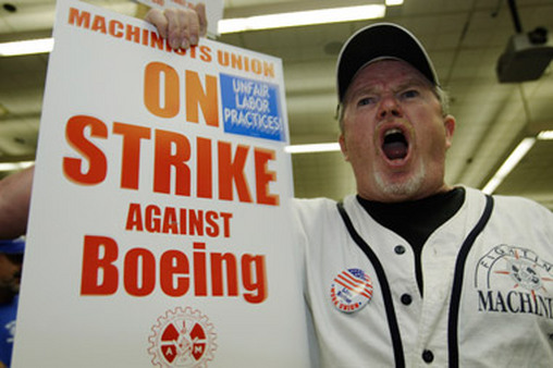 This Boeing striker yelling during a rally, helped cost Boeing millions of dollars in lost revenue. (Photo: AP)