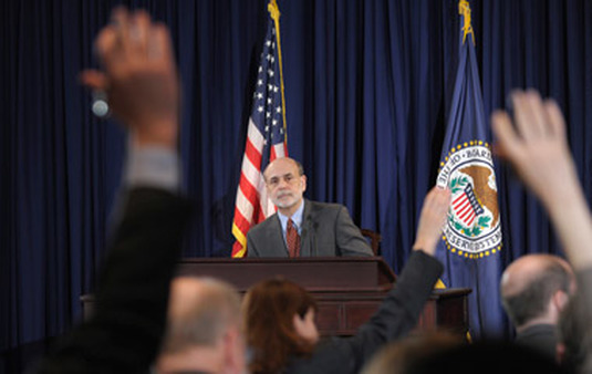 Ben Bernanke answering questions at a press conference. (Photo: AP)