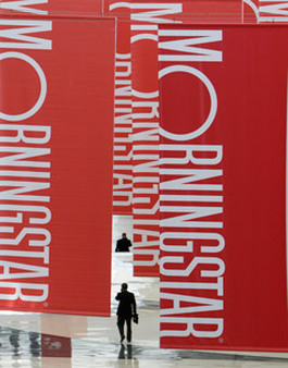 Attendees walk beneath banners at a Morningstar conference in Chicago. (Photo: AP)
