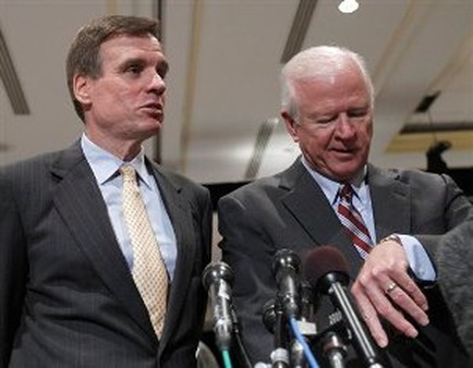 Sens. Mark Warner (left) and Saxby Chambliss say time is of the essence in dealing with the fiscal cliff. (AP Photo)