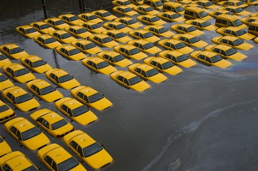 A parking lot full of yellow cabs is flooded in Hoboken, NJ. (Photo: AP)