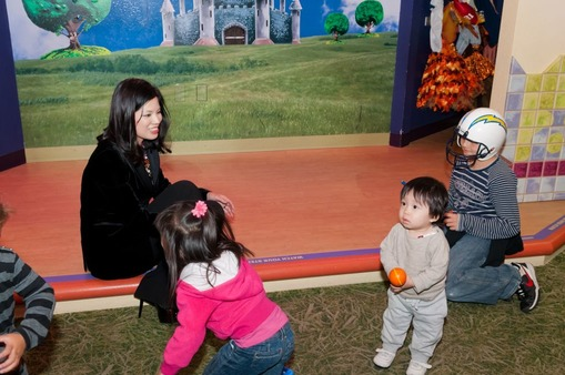 W. Sun (left) and guests enjoy a Nov. 10 visit to Pretend City.