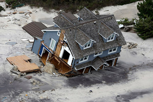 View of a collapsed house along the central Jersey Shore after Sandy