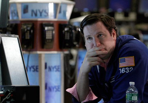 A pensive trader on the floor of the NYSE. (Photo: AP)