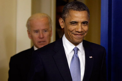 President Barack Obama and Vice President Joe Biden entering White House press room shortly after passage. (Photo: AP)