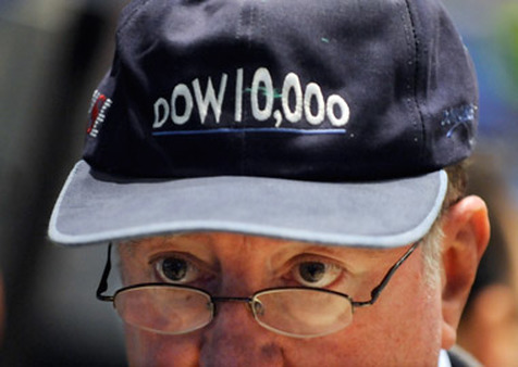 Trader wears hat touting Dow's 1999 milestone. (Photo: AP)