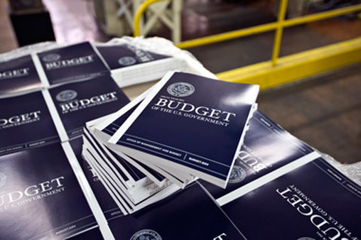Stacks of the 2014 budget wait to be distributed. (Photo: AP)