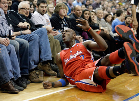 Lamar Odom takes a spill, much like his charity did. (Photo: AP)