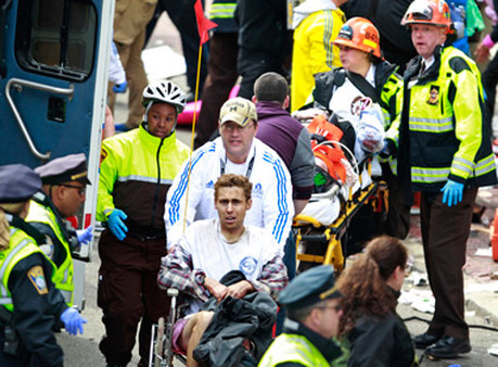 Medical workers aided injured people at the finish line. (Photo: AP)