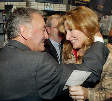 Sandy Weil hugging daughter Jessica Bibliowicz after NFP's stock went public in 2003. (Photo: AP)