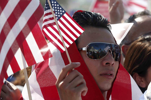 A man at a rally in April for immigration reform. (Photo: AP)