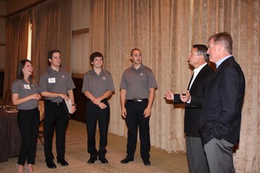 Walt Bettinger, second from right, and Bernie Clark, far right, speak to interns at the Schwab Explore conference.