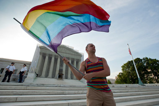 A gay-marriage advocate awaited the decisions on the steps of the Supreme Court Wednesday morning. (Photo: AP)