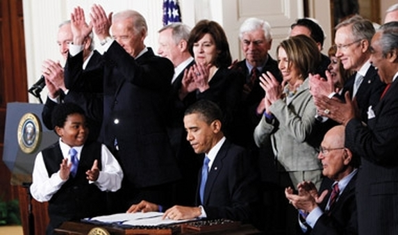 President Obama signing the healthcare overhaul bill in 2010. (Photo: AP)