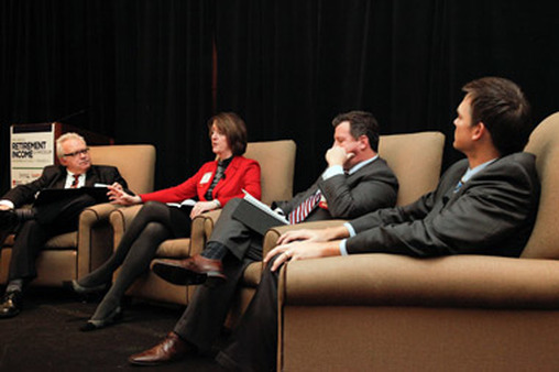 Carina Diamond speaking at a Retirement Income Symposium panel in Chicago on Nov. 8, led by AdvisorOne Editor Jamie Green (far left).