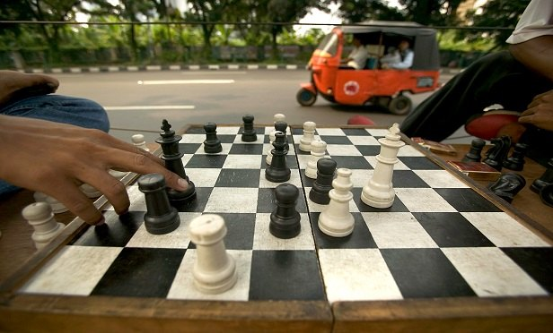 Men playing chess