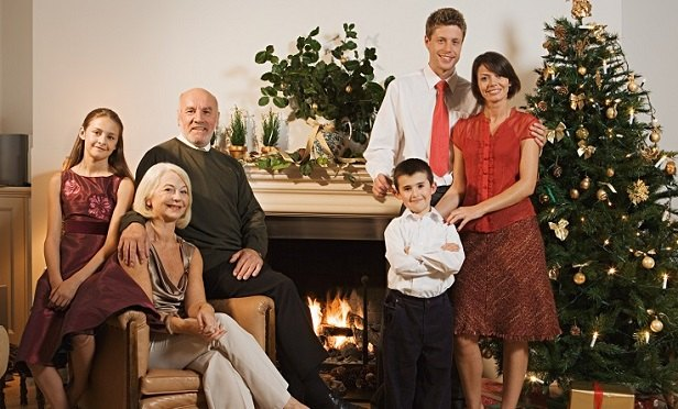 Grandparents, adult children and grandchildren in a Christmas card photo